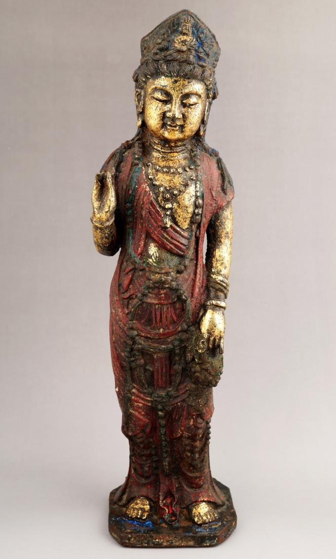 A GILT- LACQUERED METAL FIGURE OF GUANYIN BUDDHA.