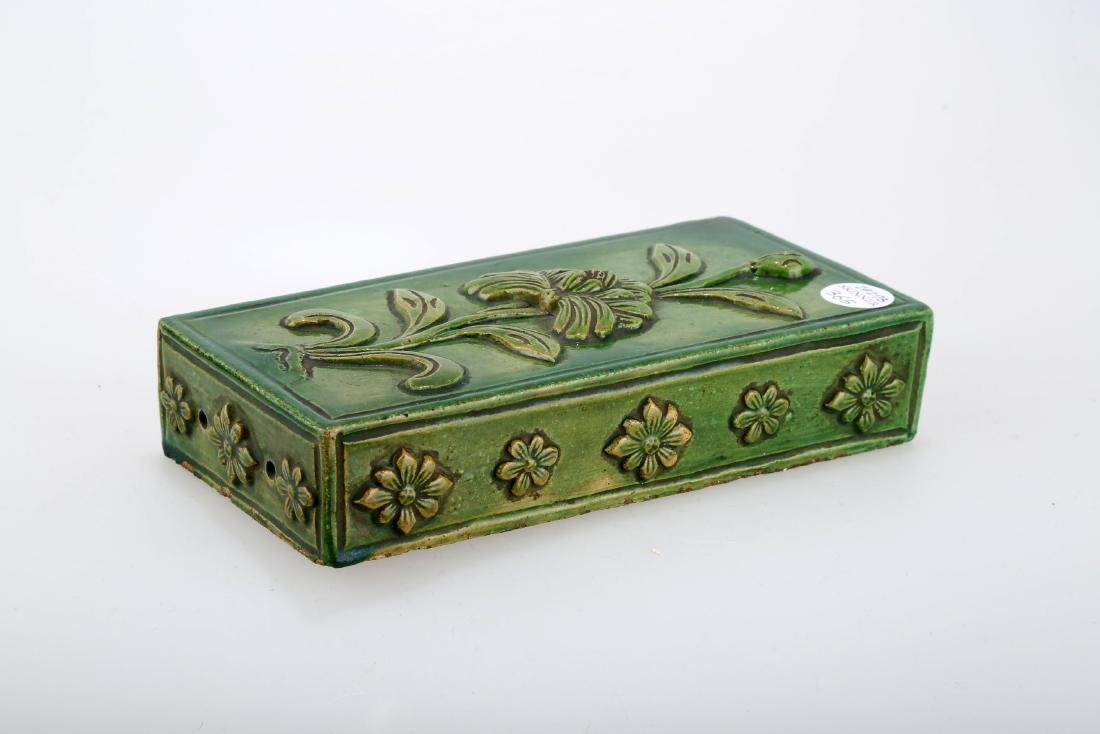 A TRANSITIONAL PERIOD GREEN-GLAZED CERAMIC TILE.C259.