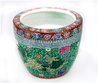 A CORAL AND GREEN GROUND FAMILLE ROSE PORCELAIN