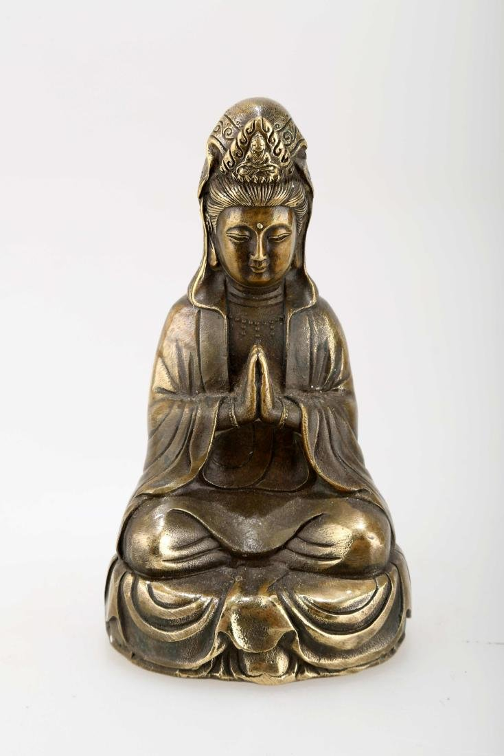 A BRONZE GUANYIN STATUE. THE BASE CARVED WITH MING - 2