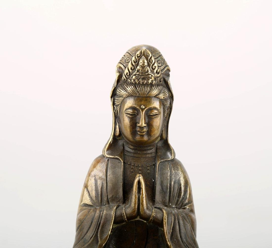 A BRONZE GUANYIN STATUE. THE BASE CARVED WITH MING - 4
