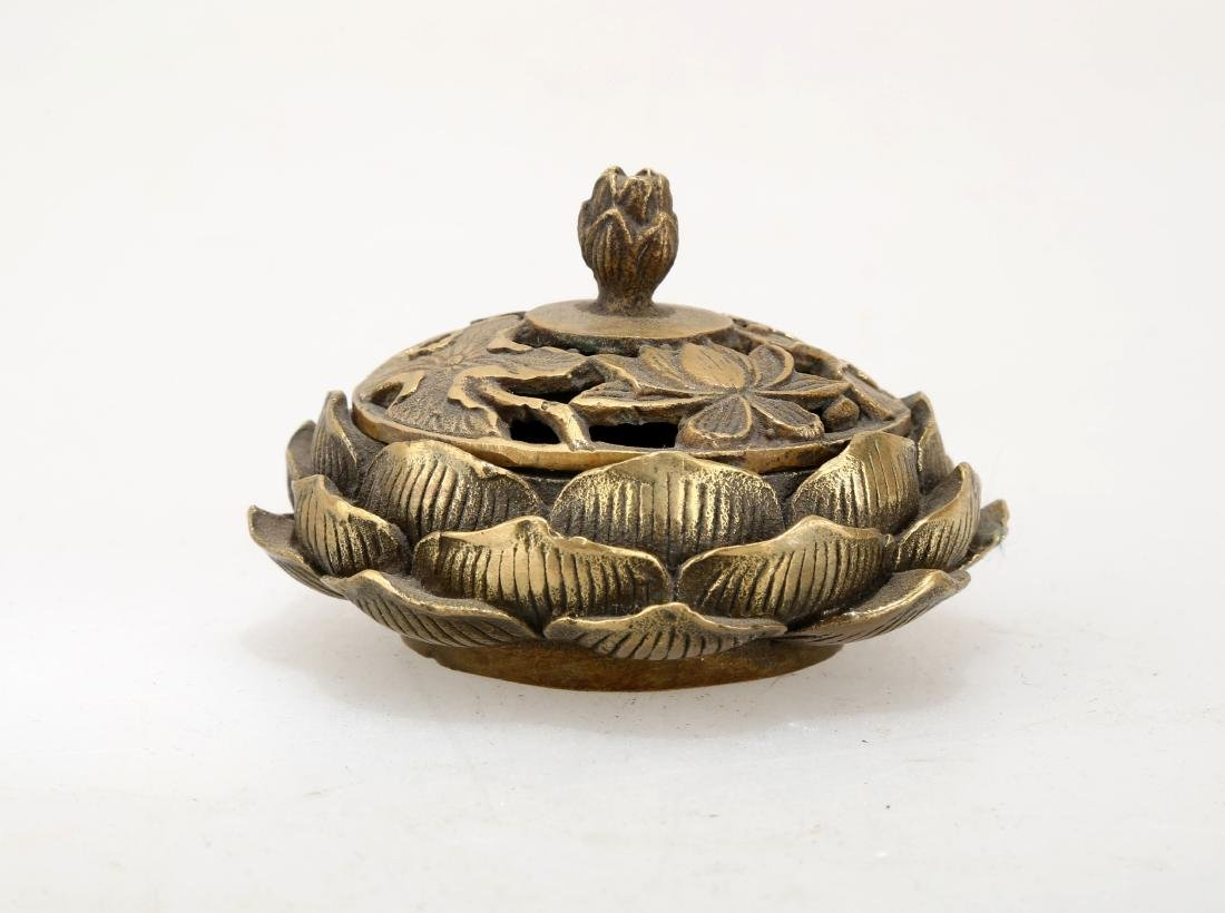 A BRONZE LOTIFORM CENSER. THE BASE CARVED WITH QIAN