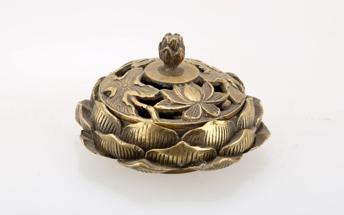 A BRONZE LOTIFORM CENSER. THE BASE CARVED WITH QIAN - 3
