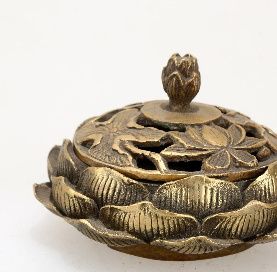 A BRONZE LOTIFORM CENSER. THE BASE CARVED WITH QIAN - 4