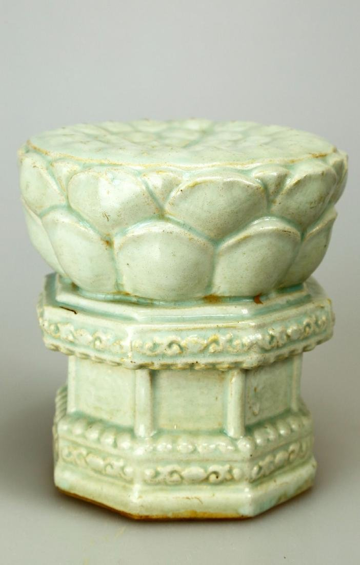 A YINGQING LOTUS-SEAT WITH INCISED FLOWERS DECORATION.