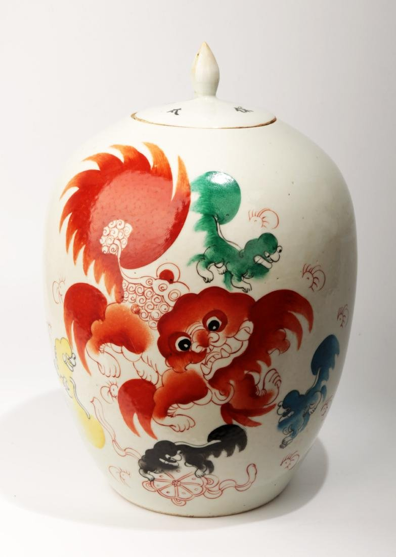 A IRON RED GLAZED PROCELAIN JAR AND COVER PAINTED WITH