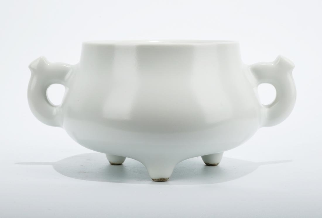 A BLANC-DE-CHINA TRIPOD CENSER WITH TWO EARHANDLES.THE