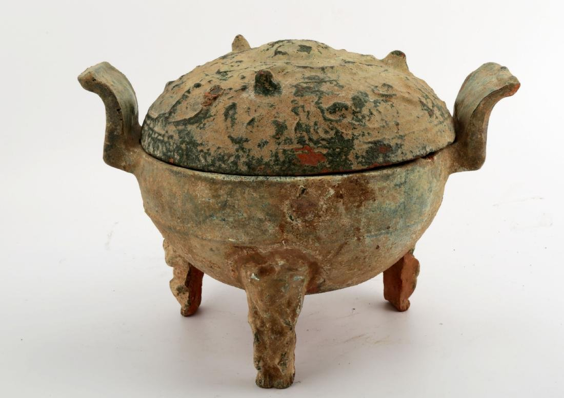 A HAN DYNASTY GREEN GLAZED DING-FORM JAR AND COVER.