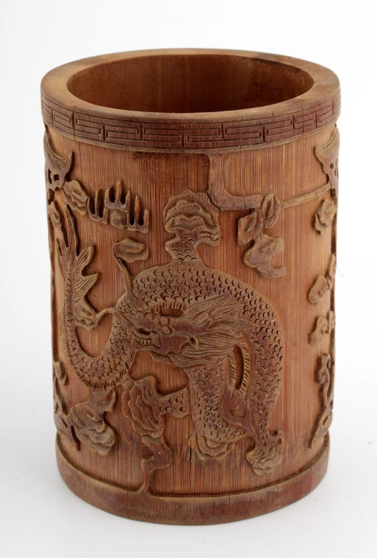 A CHINESE CARVED WITH DRAGONS BAMBOO BRUSH POT.