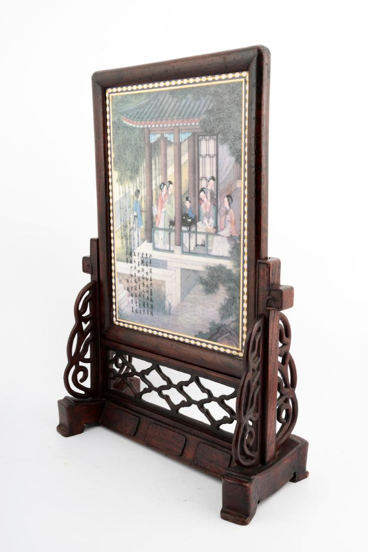 A WOOD FIGURE TABLE SCREEN