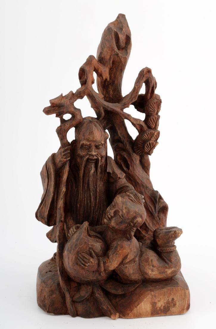 A CHINESE ZHANGMU WOOD FIGURE OF AN OLD MAN AND A