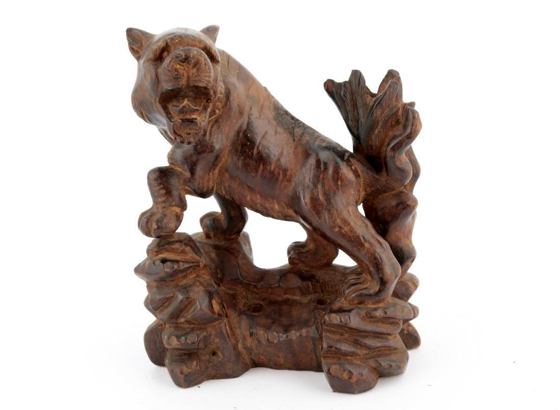 A CHINESE HARDWOOD STATUE OF A TIGER