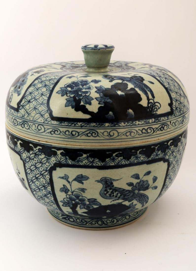 A BLUE AND WHITE FLOWERS AND BIRDS JAR AND COVER. WITH