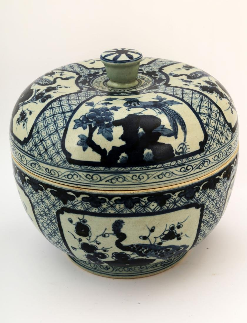 A BLUE AND WHITE FLOWERS AND BIRDS JAR AND COVER. WITH - 3