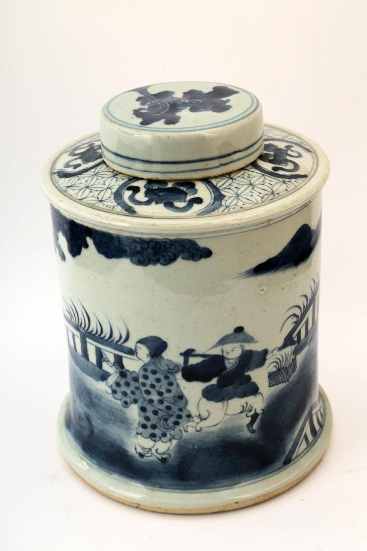 A BLUE AND WHITE FIGURE COLUMN JAR AND COVER.