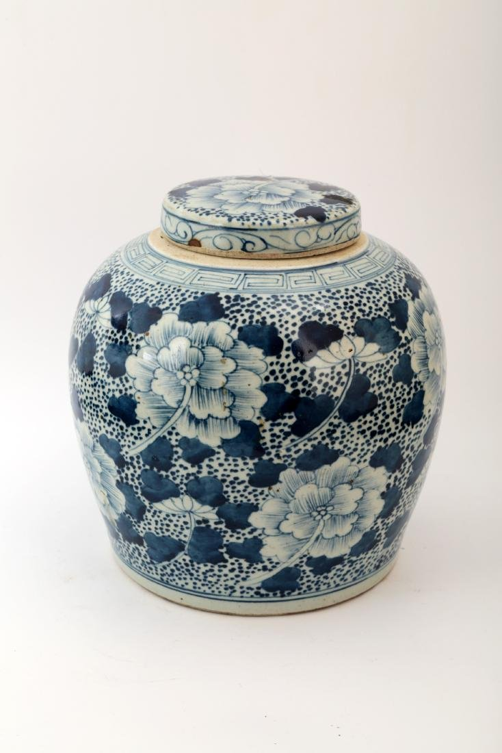 A BLUE AND WHITE PEONY JAR AND COVER