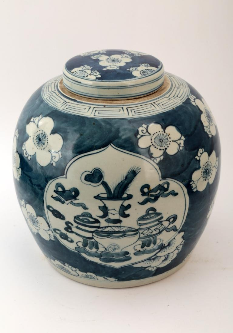 A BLUE AND WHITE BOGUTU JAR AND COVER