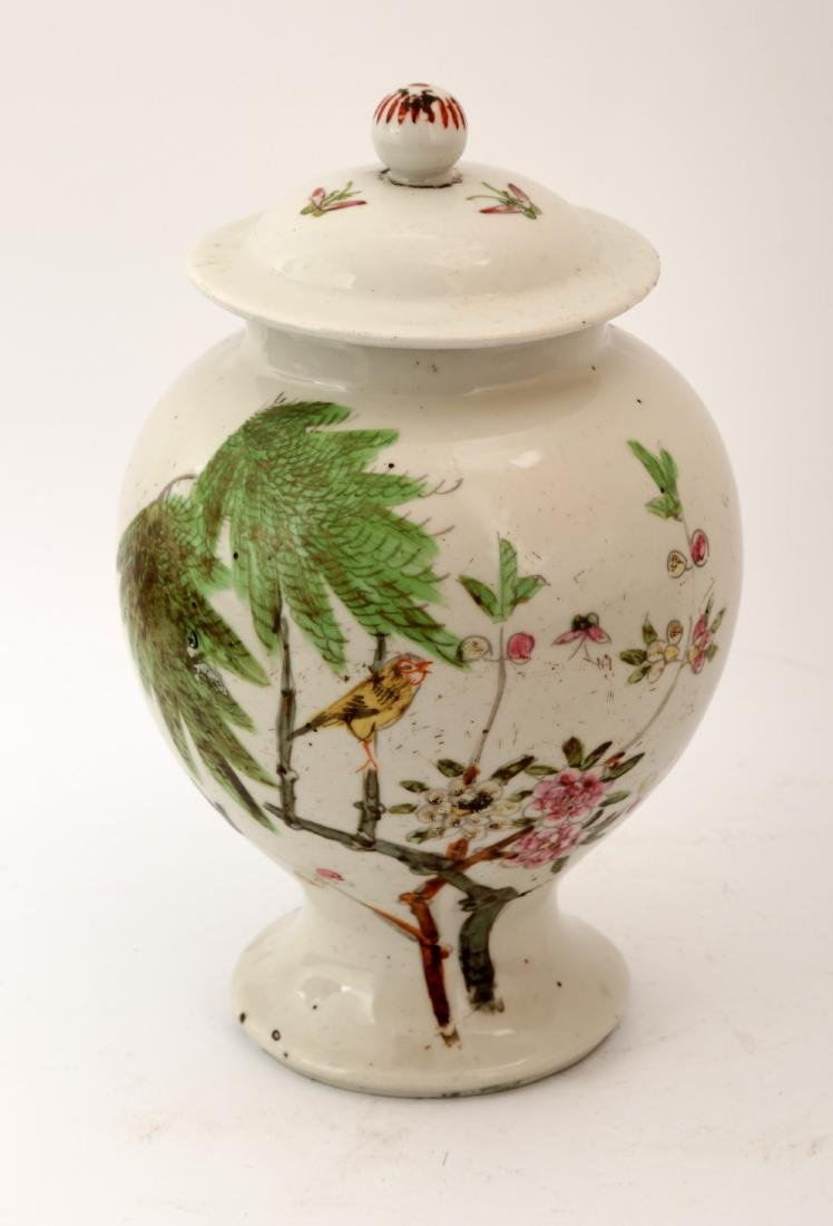 A FAMILLE ROSE FLOWERS AND BIRDS JAR AND COVER