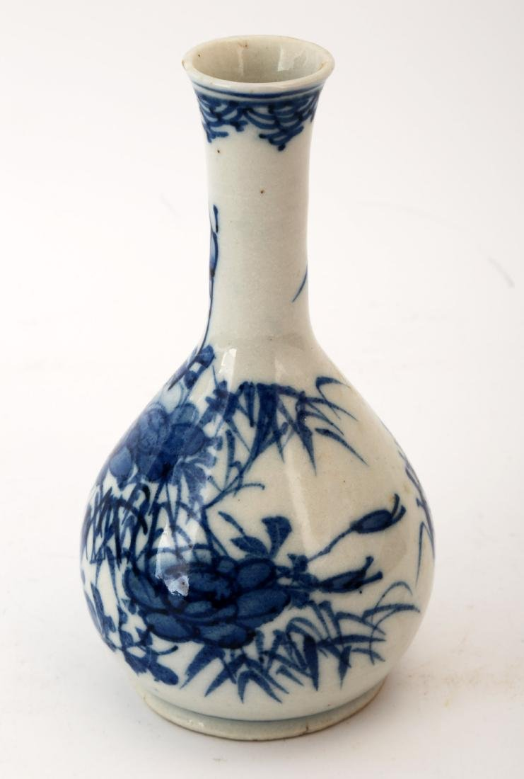 A SMALL BLUE AND WHITE BAMBOO LANDSCAPE VASE.