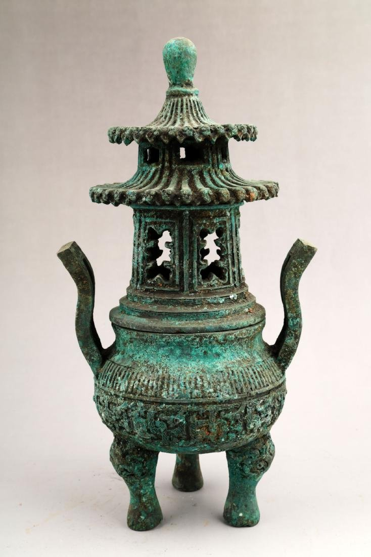 A BRONZE TRIPOD CENSER AND COVER.