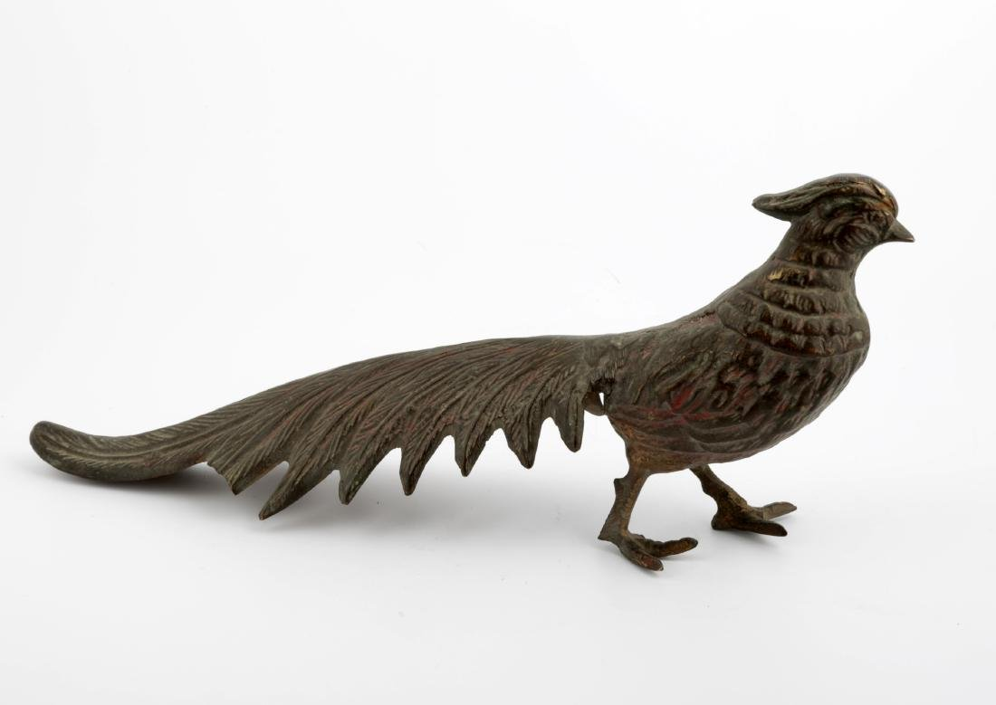 A CHINESE BRONZE PEACOCK SCULPTURE.