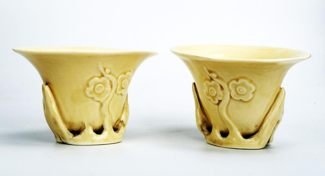 (2) A PAIR OF CARVED 'DEHUA' BLANC-DE-CHINE LIBATION