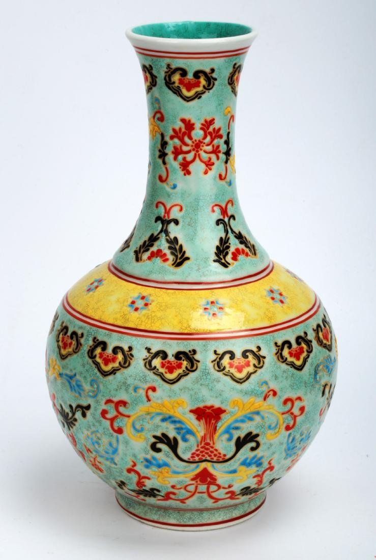 A TURQUOISE-GROUND PAINTED ENAMEL WITH COLOR GLAZED