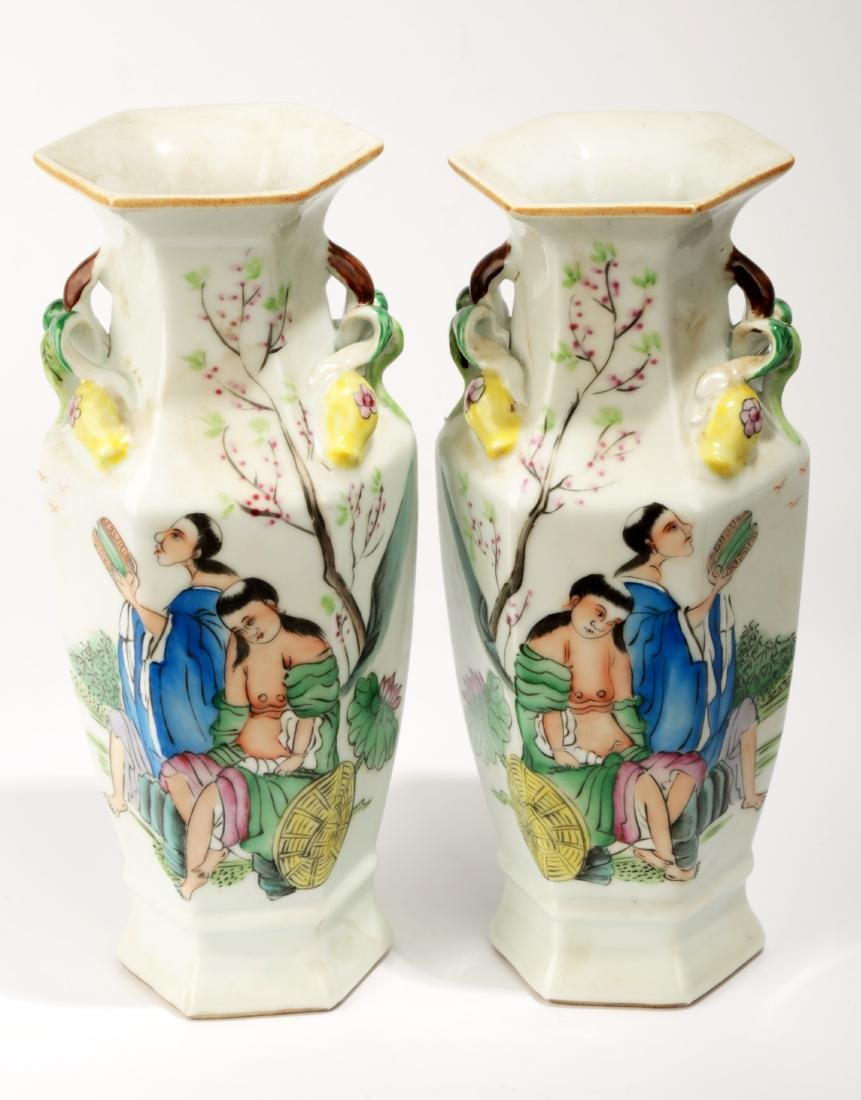 (2) A PAIR OF FAMILLE ROSE GODS OF HE-HE OCTAGONAL