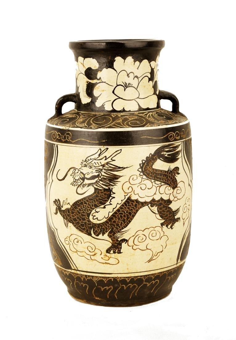 A GARNET-GLAZE CARVED WITH LOTUS FLOWERS, DRAGON AND