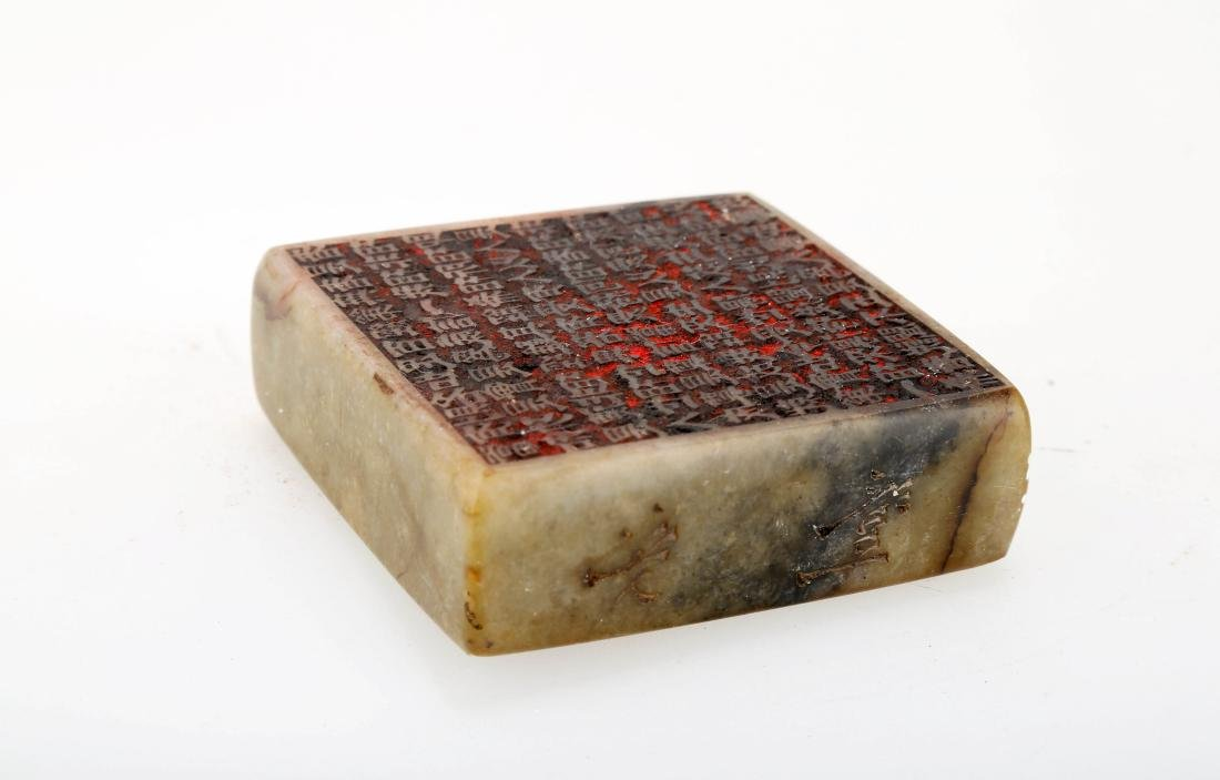 A QING-STYLE SUET WHITE JADE BI-DISK WITH DOUBLE-SIDED