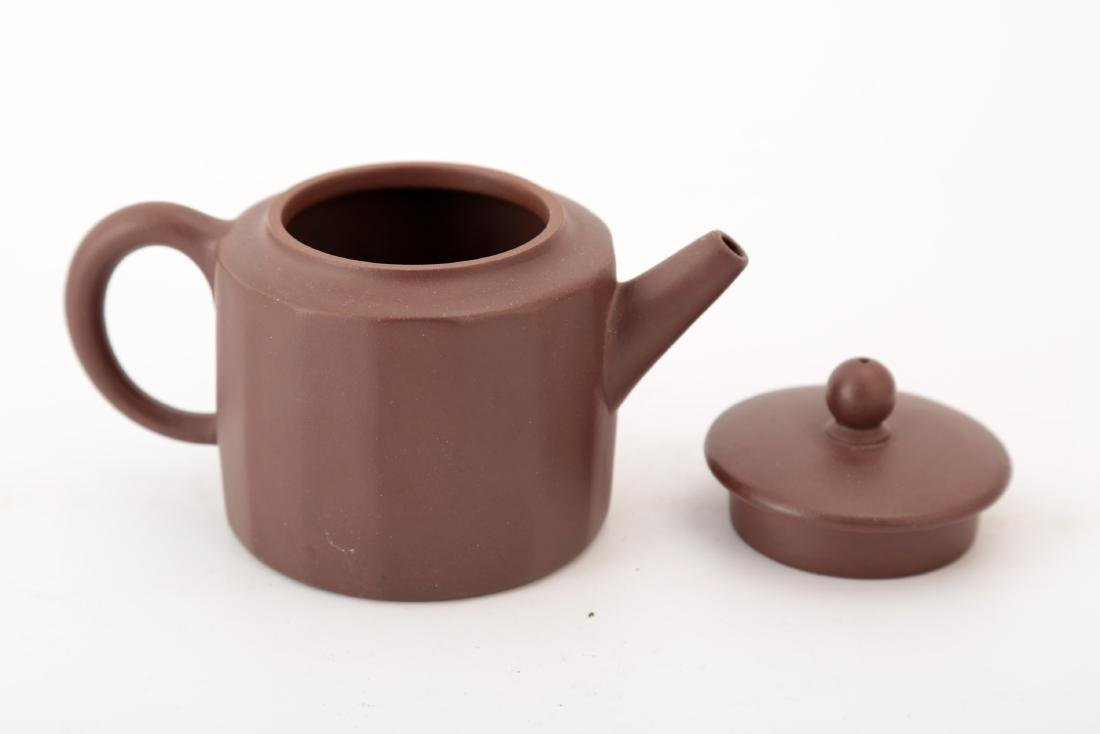 A CLAY TEAPOT WITH MELON RIDGES. - 2