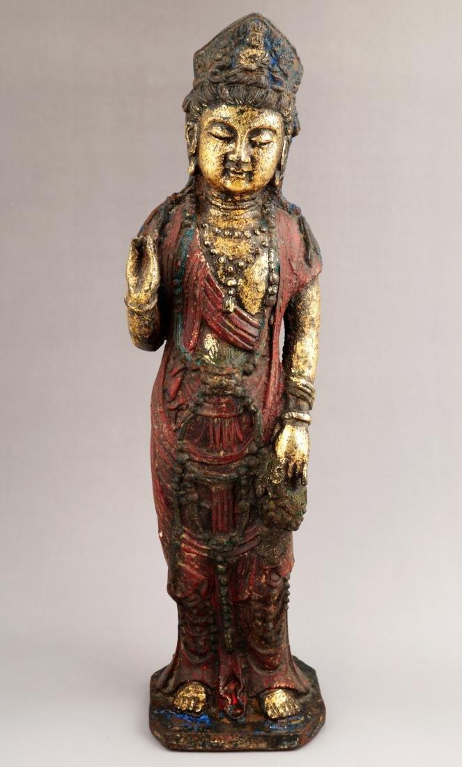A GILT- LACQUERED METAL FIGURE OF GUANYIN BUDDHA.