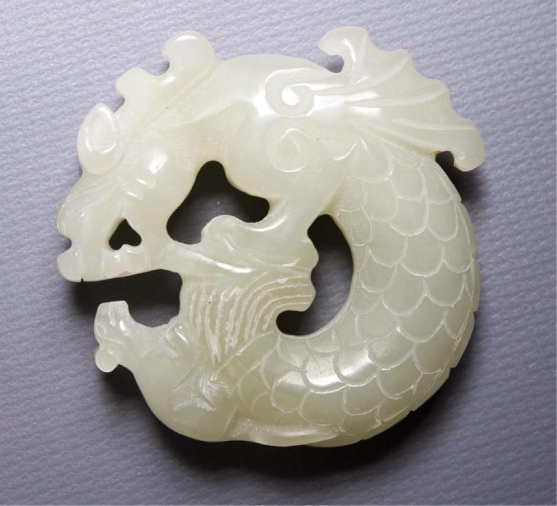 A CHINESE JADE (POSSIBLY JADEITE) BI-DISK WITH