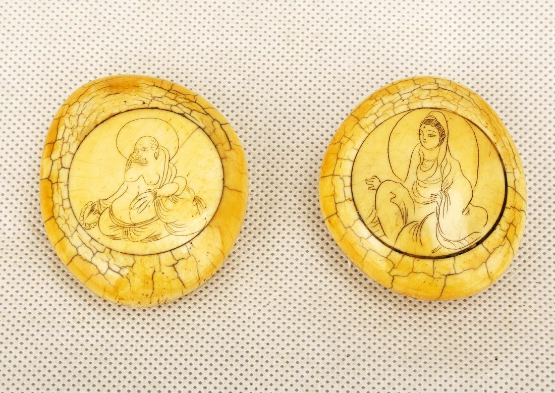 (2)  A PAIR OF ORNAMENTS DESIGNED WITH FIGURES OF