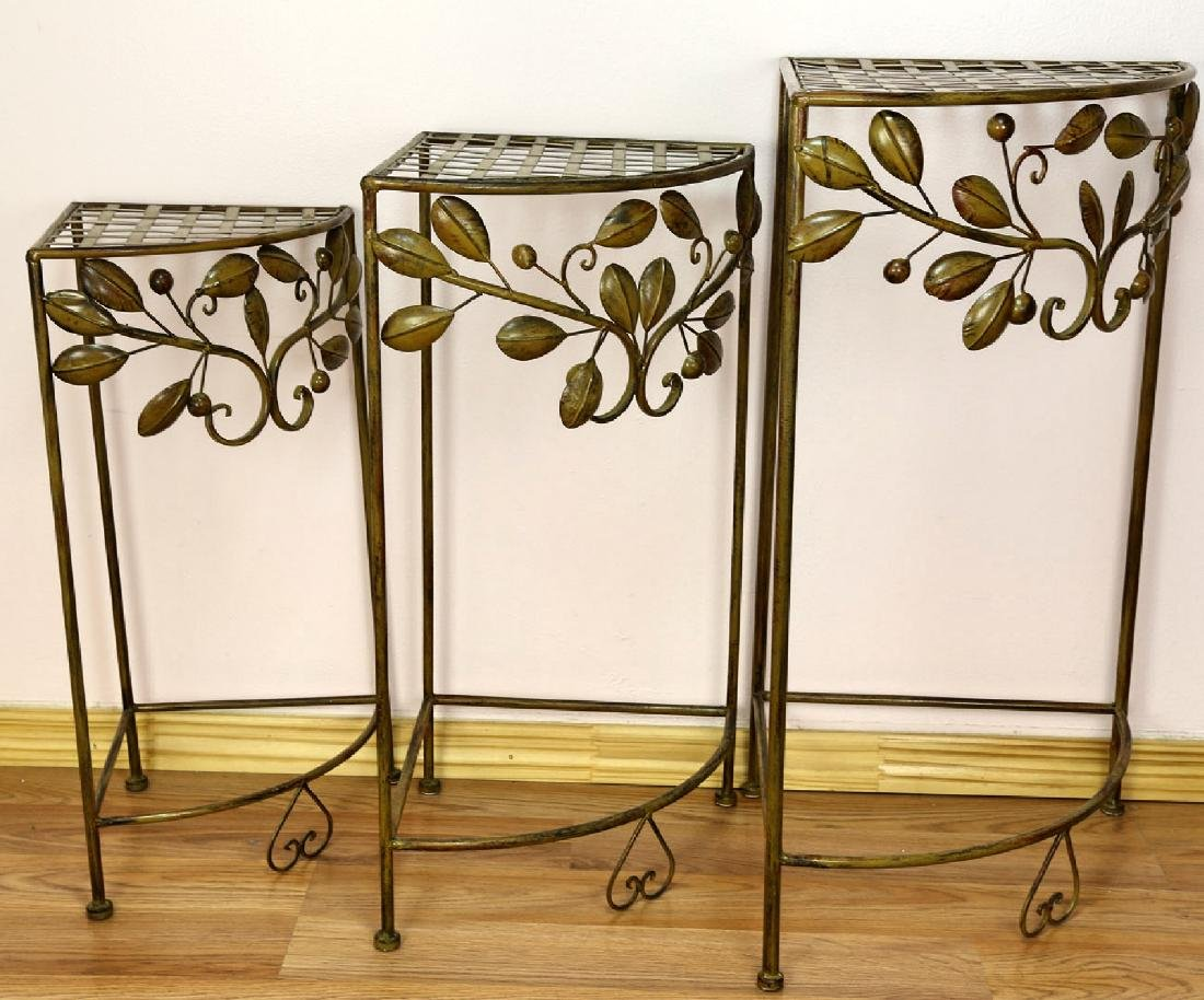 (3) A SET OF THREE ART DECO WROUGHT IRON PLANT STANDS .