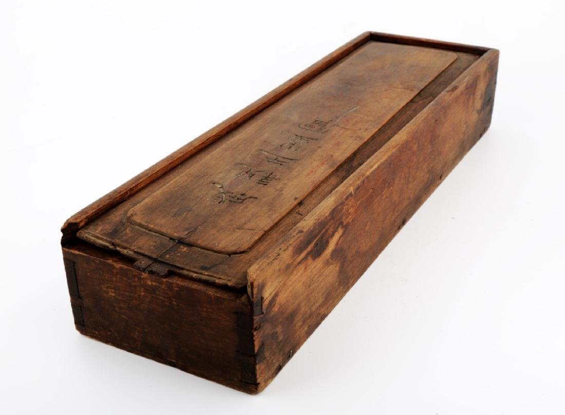 A WOODEN BOX FOR SCROLL PAINTING. THE SURFACE MARKED