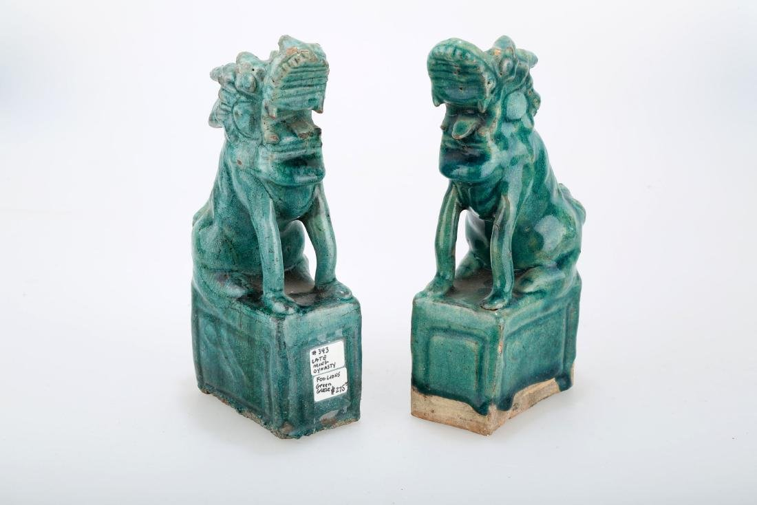 (2)   A PAIR OF CHINESE MING-STYLE GREEN GLAZE LION
