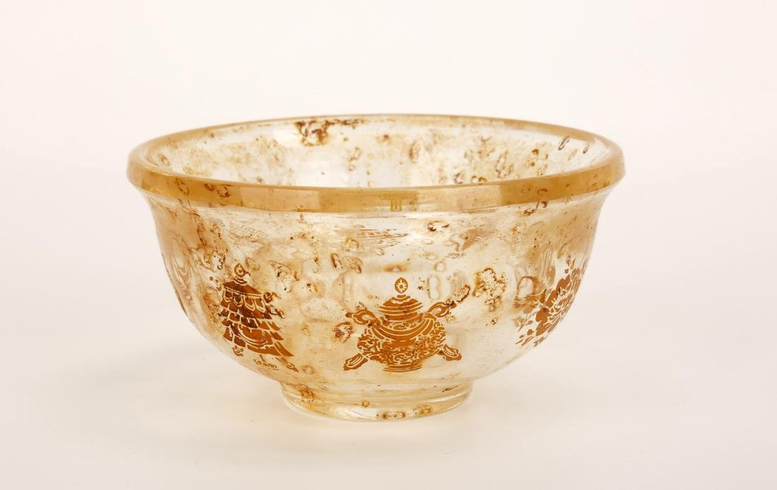 A GILT CRYSTAL DRINKING BOWL CARVED WITH VARIETIES OF