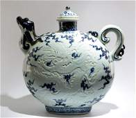A BLUE AND WHITE CARVED CELADON MOONFLASK WITH DESIGN