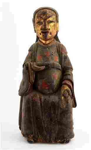 A GILT- LACQUERED WOOD FIGURE OF A DAOIST IMMORTAL