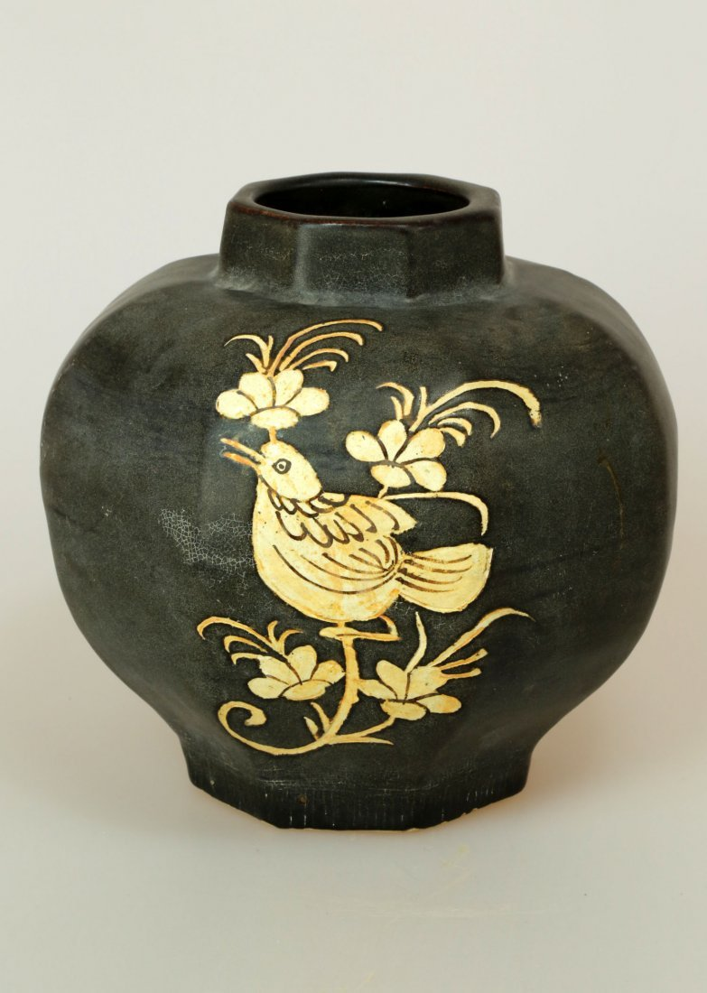 BLACK GLAZE CARVED FLOWER HEXAGONAL JAR.
