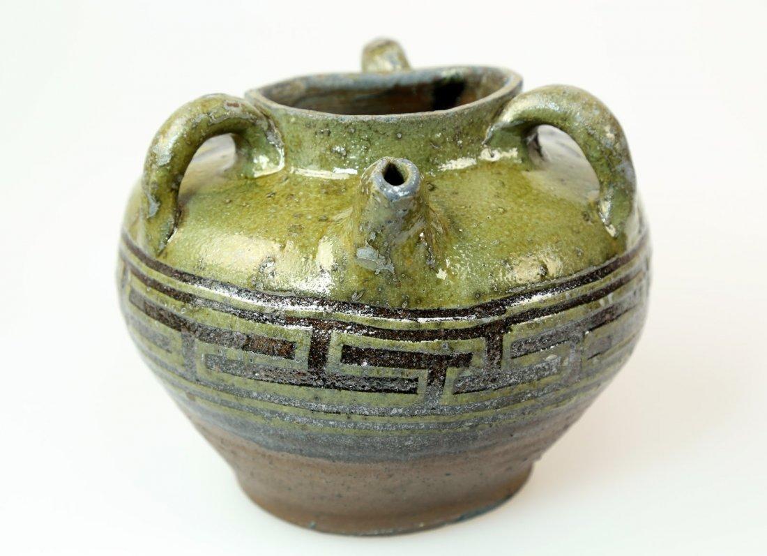 A BROWN GREEN GLAZE OF CARVED PORCELAIN JAR