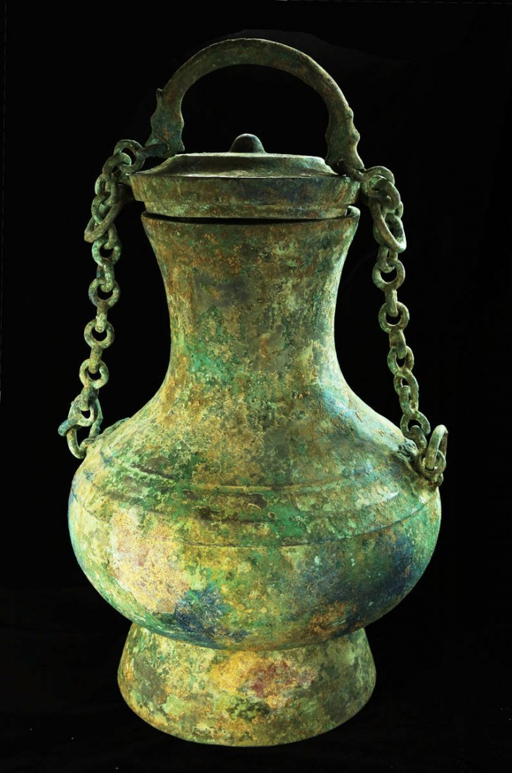 LARGE ARCHAIC BRONZE LIFTING HANDLE POT, HAN DYNASTY,