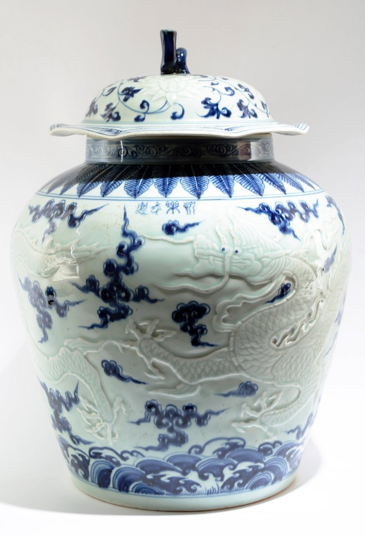 AN UNUSUAL CHINESE BLUE AND WHITE CARVED CELADON JRA AN