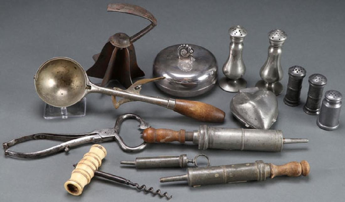 A COLLECTION OF PRIMITIVE KITCHEN UTENSILS