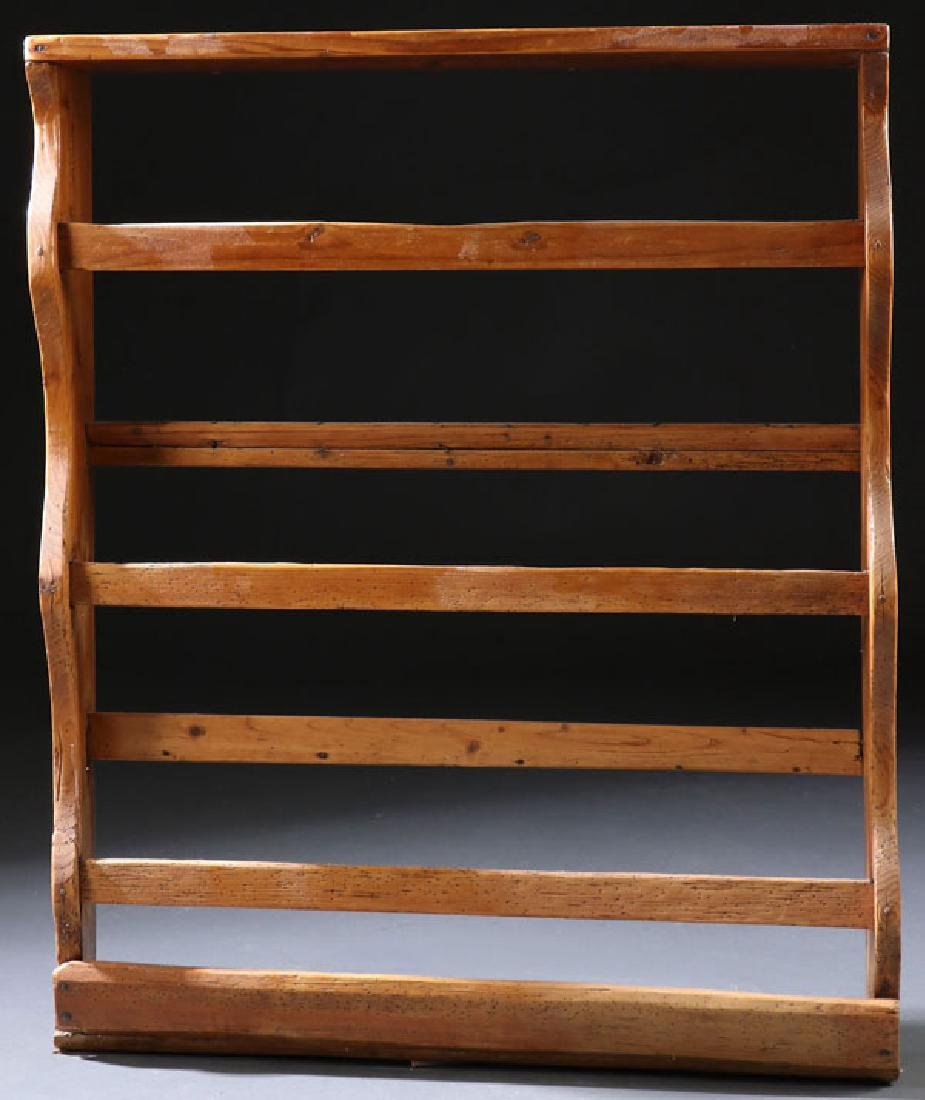 AN EARLY AMERICAN PINE PLATE RACK, LATE 18TH C