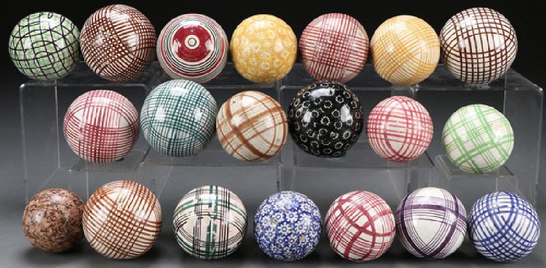 19 STAFFORDSHIRE POTTERY CARPET BALLS