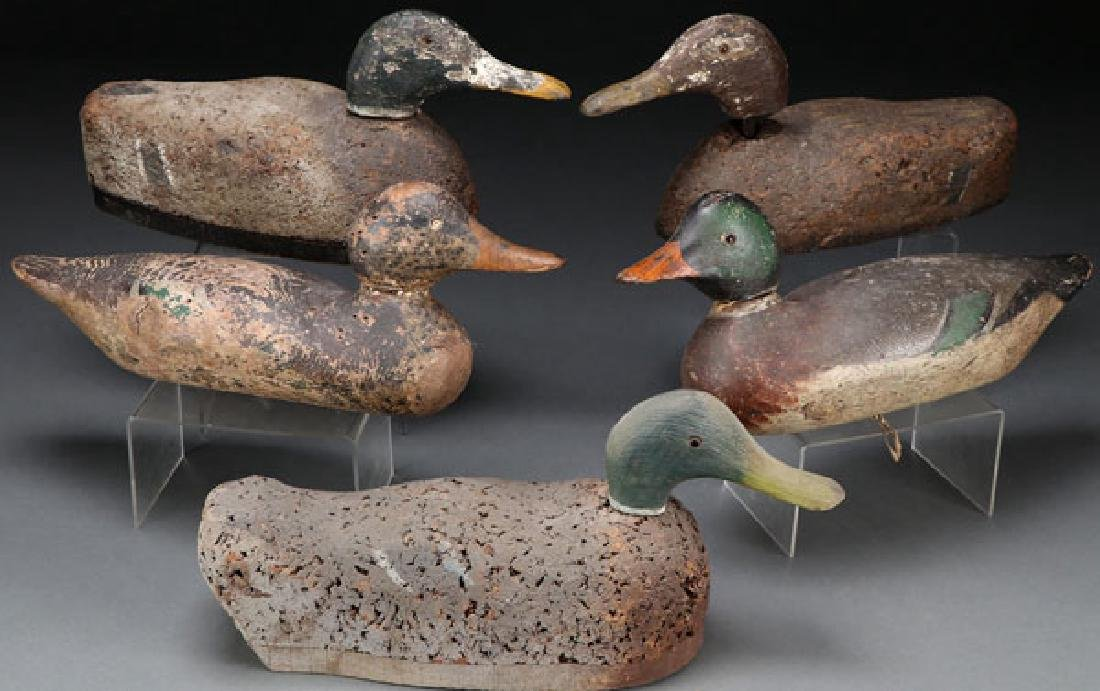 FIVE WOOD AND CORK PAINTED DUCK DECOYS