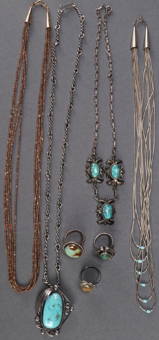 A COLLECTION OF NATIVE AMERICAN SILVER JEWELRY