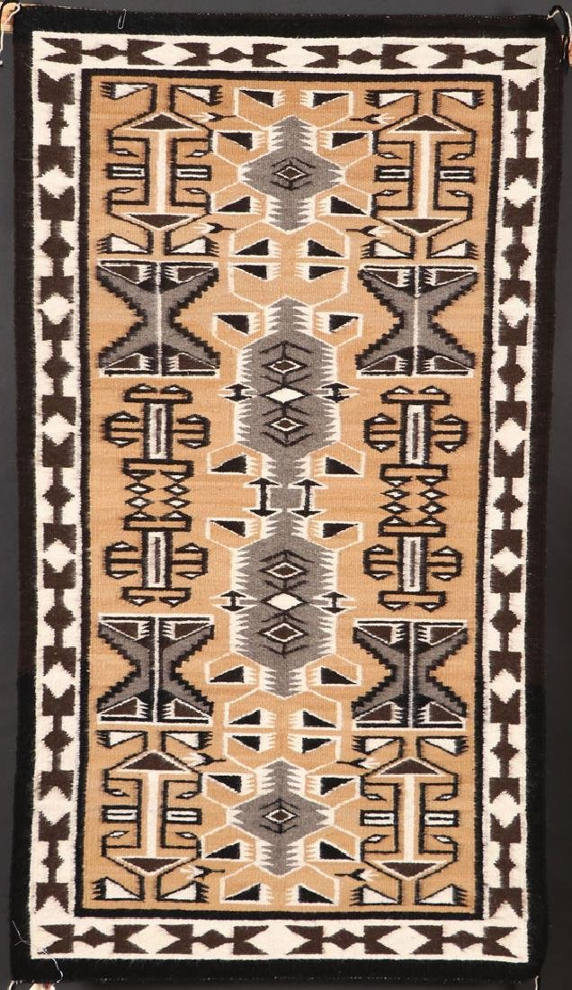 A GROUP OF FIVE SOUTHWEST NAVAJO HANDWOVEN RUG